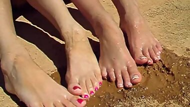 Four sexy and muddy feet